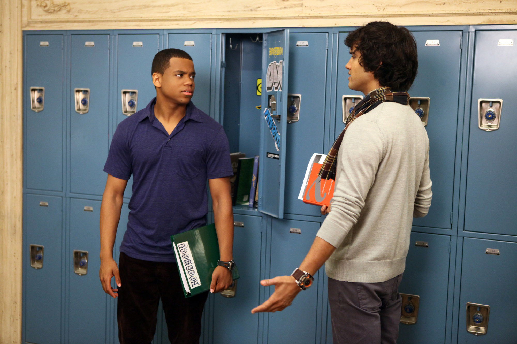 Dixon and Navid talking in the hall on 90210
