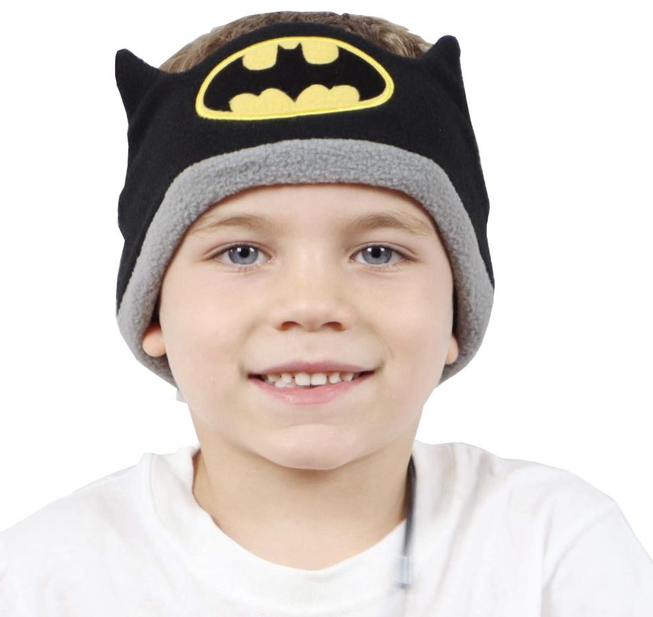 Child wearing Batman-themed headband earbuds