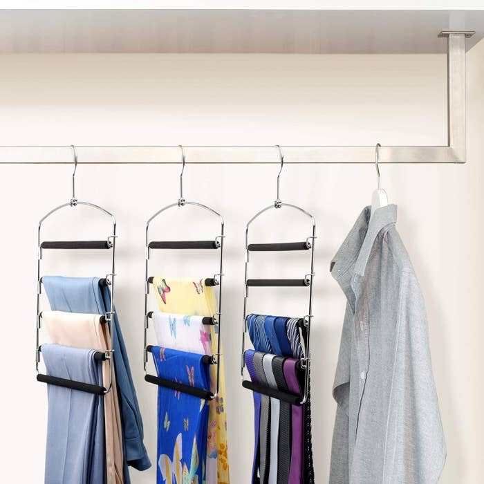 scarves hanging from the hangers in a closet