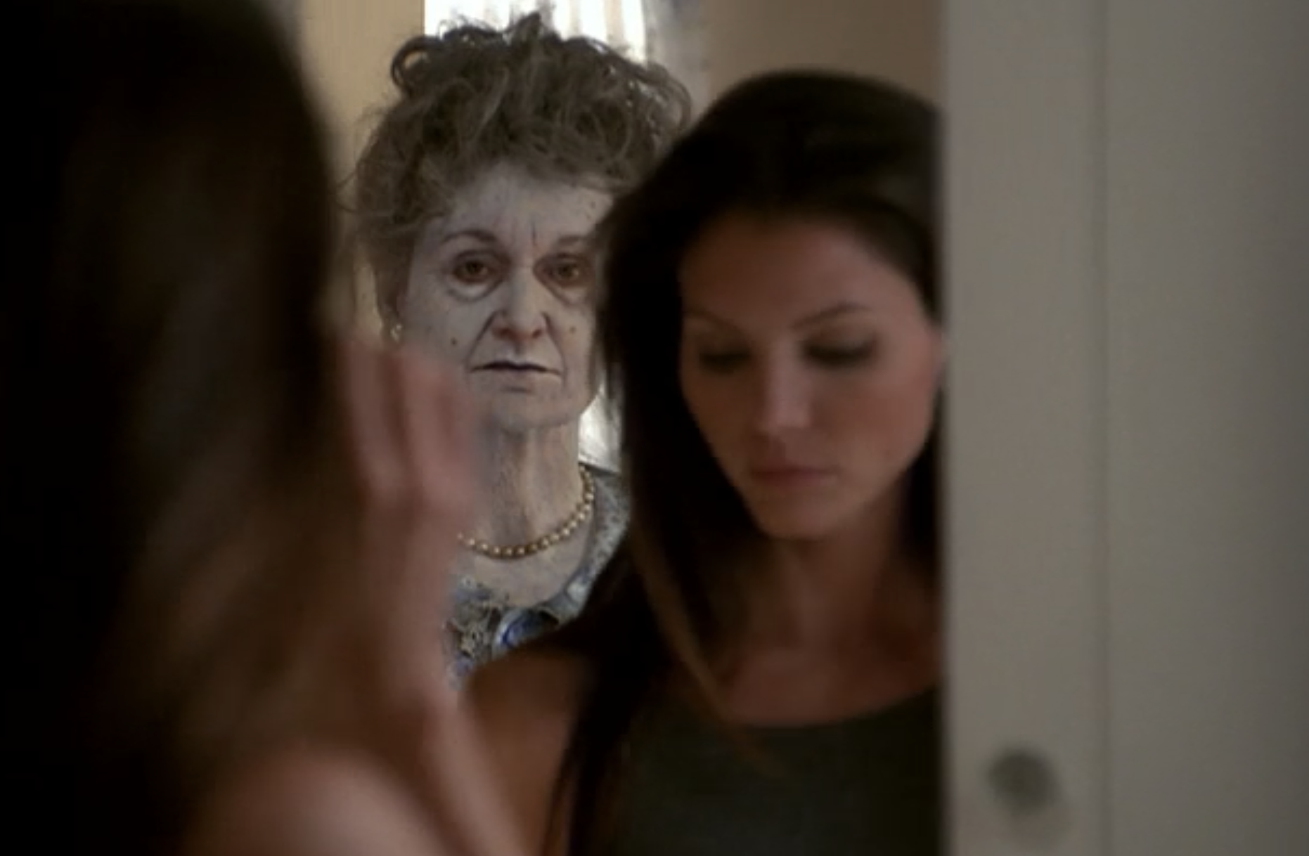 In Angel, Cordelia looks down and a ghost appears in the mirror