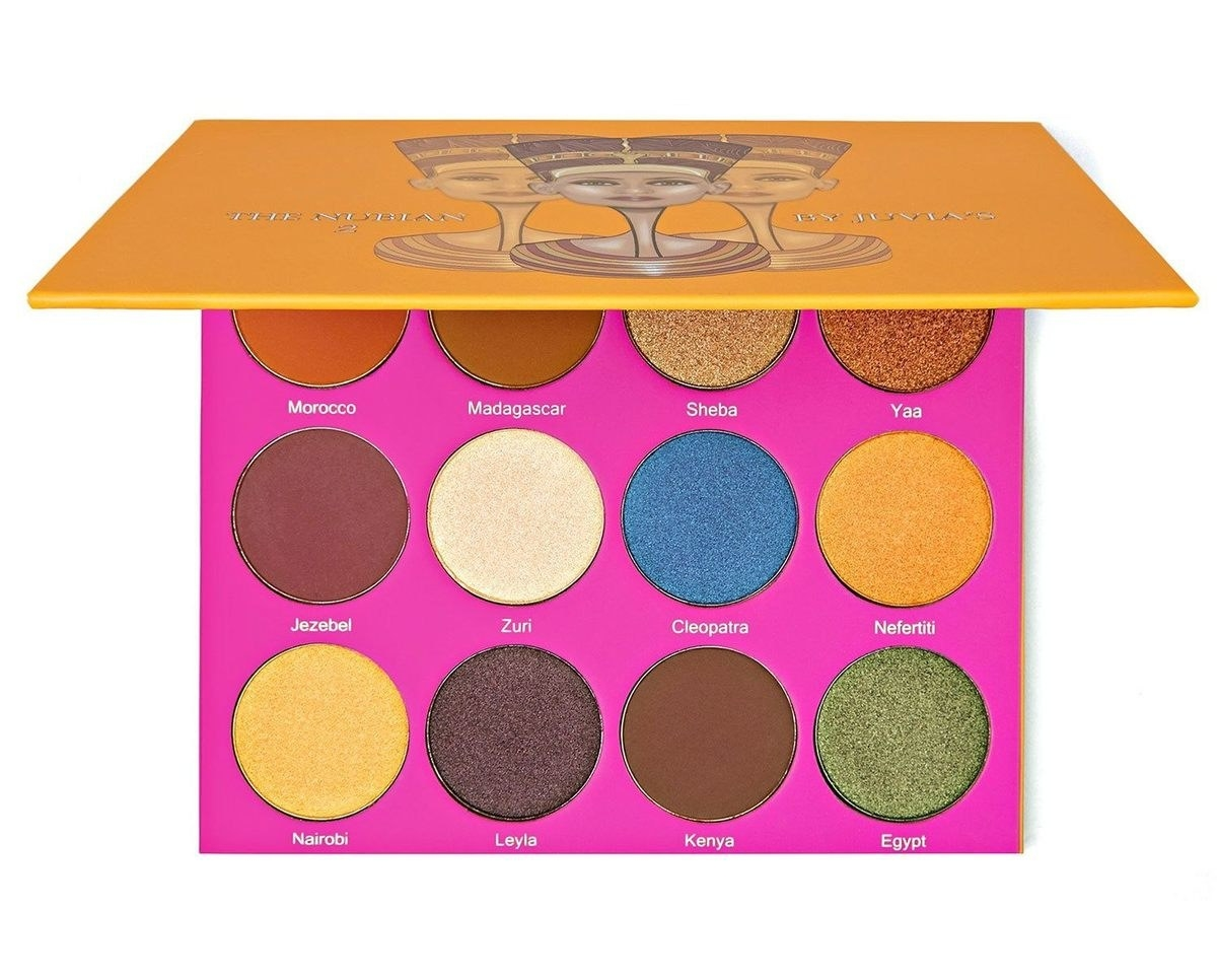 Nubian 2 palette with yellow, blue, green, and brown eyeshadow shades