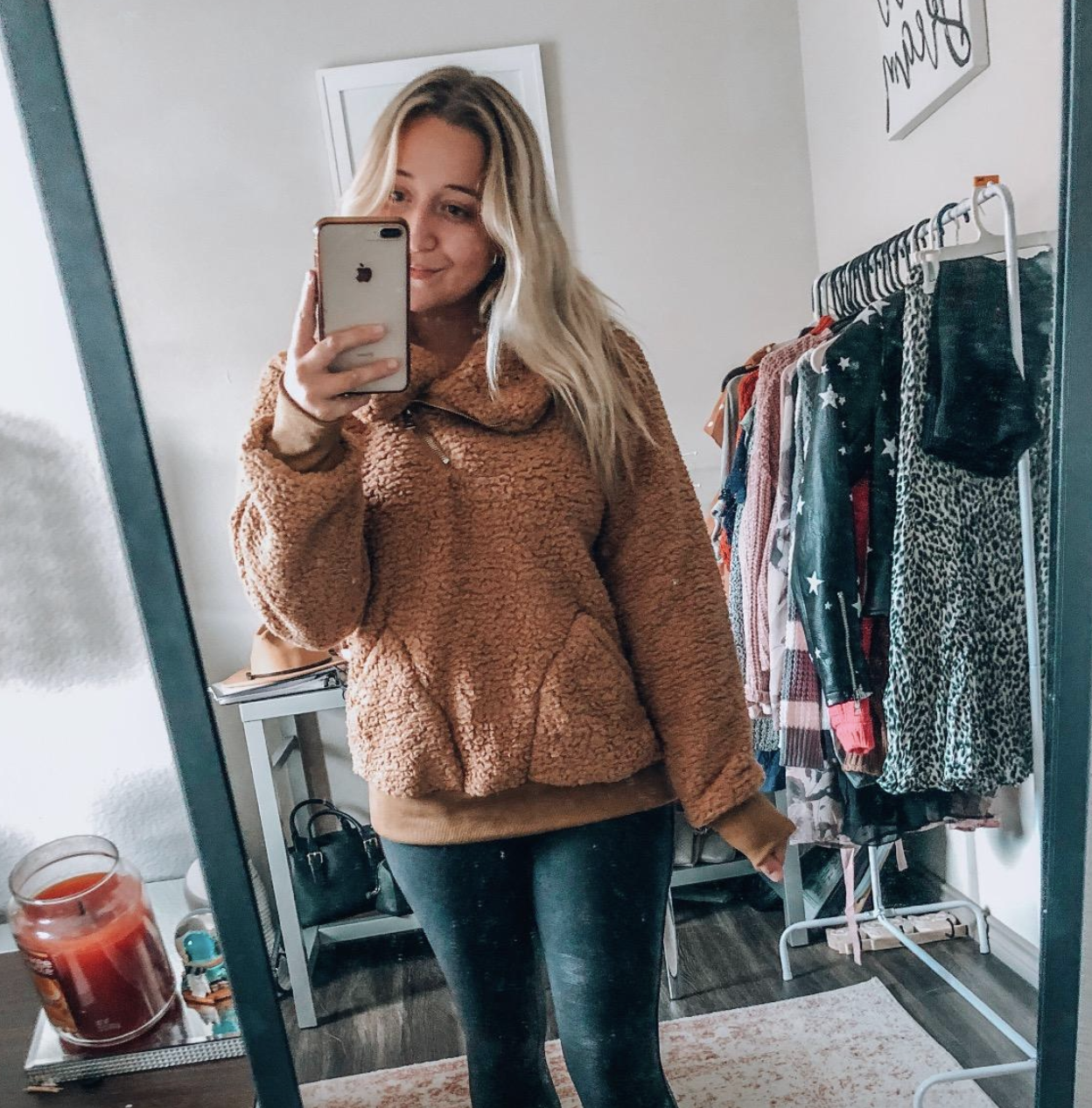 reviewer wearing the taupe sweater