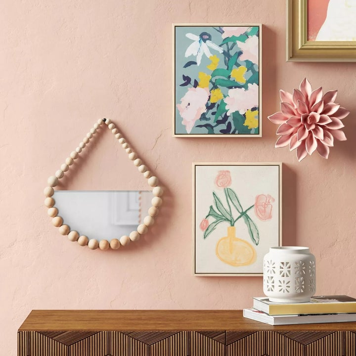 The same framed art hung up among decorative items