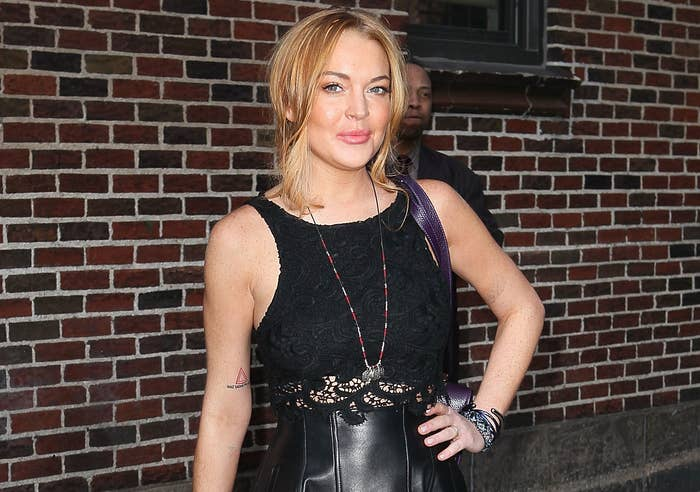 Lindsay Lohan posing in a black outfit