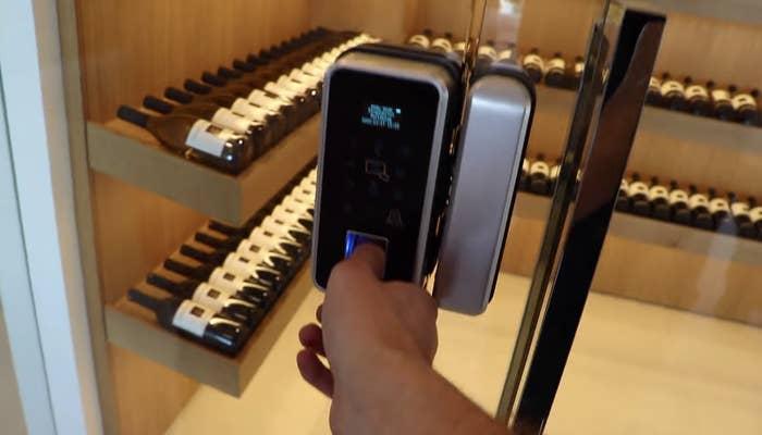 Wine room with a thumb sensor