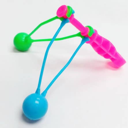 A lime green, neon blue, and neon pink clacker