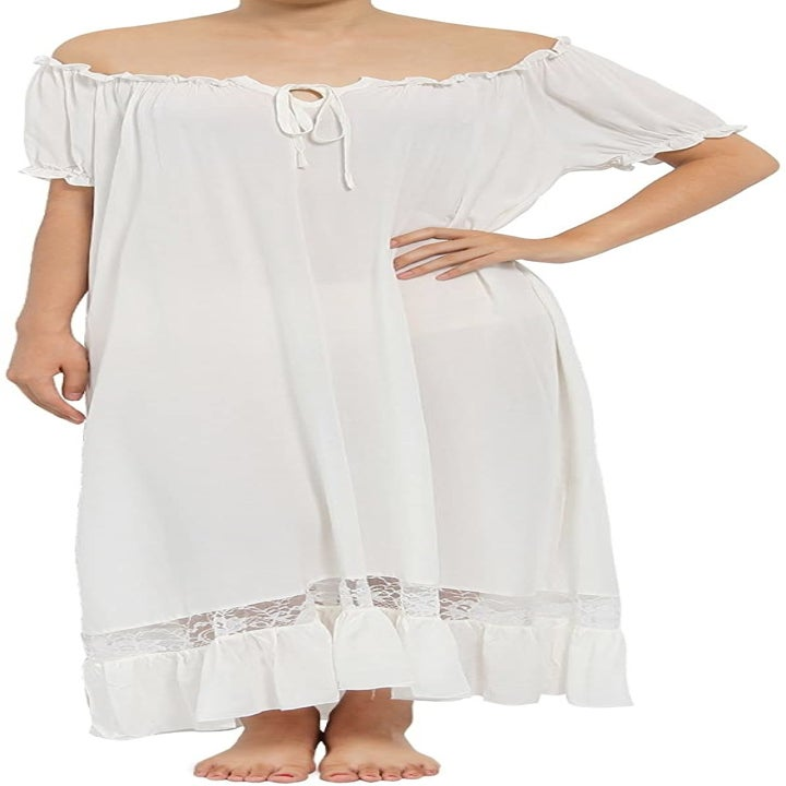 model wearing white long loose dress with lace trim