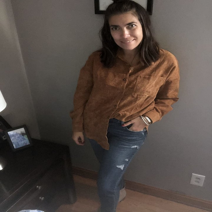 reviewer wearing the shirt in light brown