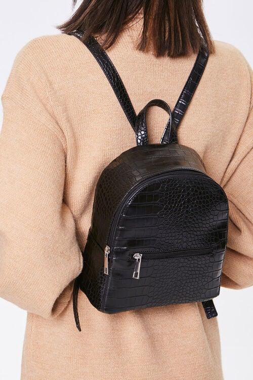 Model wearing black backpack