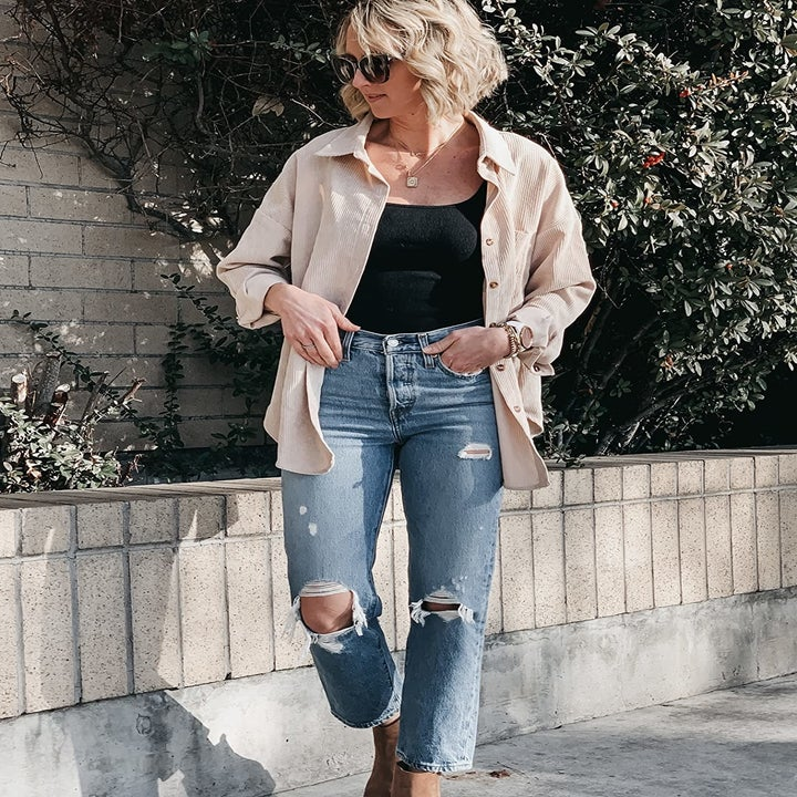 reviewer wearing the top in beige
