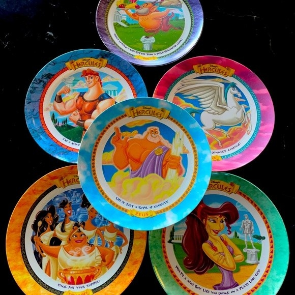A set of six different Hercules plates with the characters on them