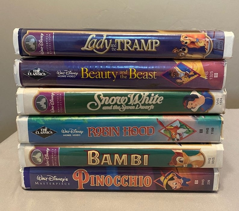 Six Disney clamshell VHS tapes stacked on each other