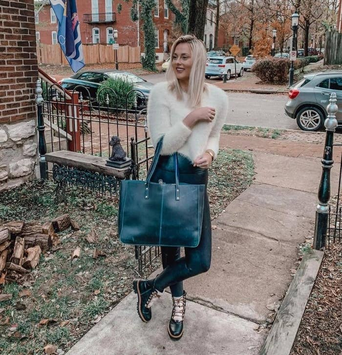 a reviewer holding the tote in black