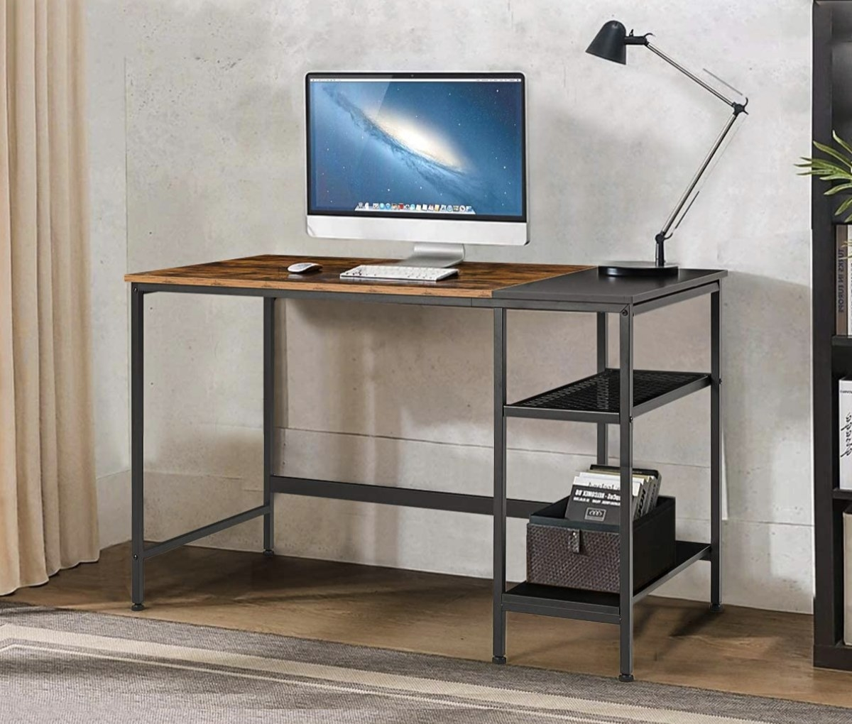 A gray metal and wood desk with open shelves on the right side