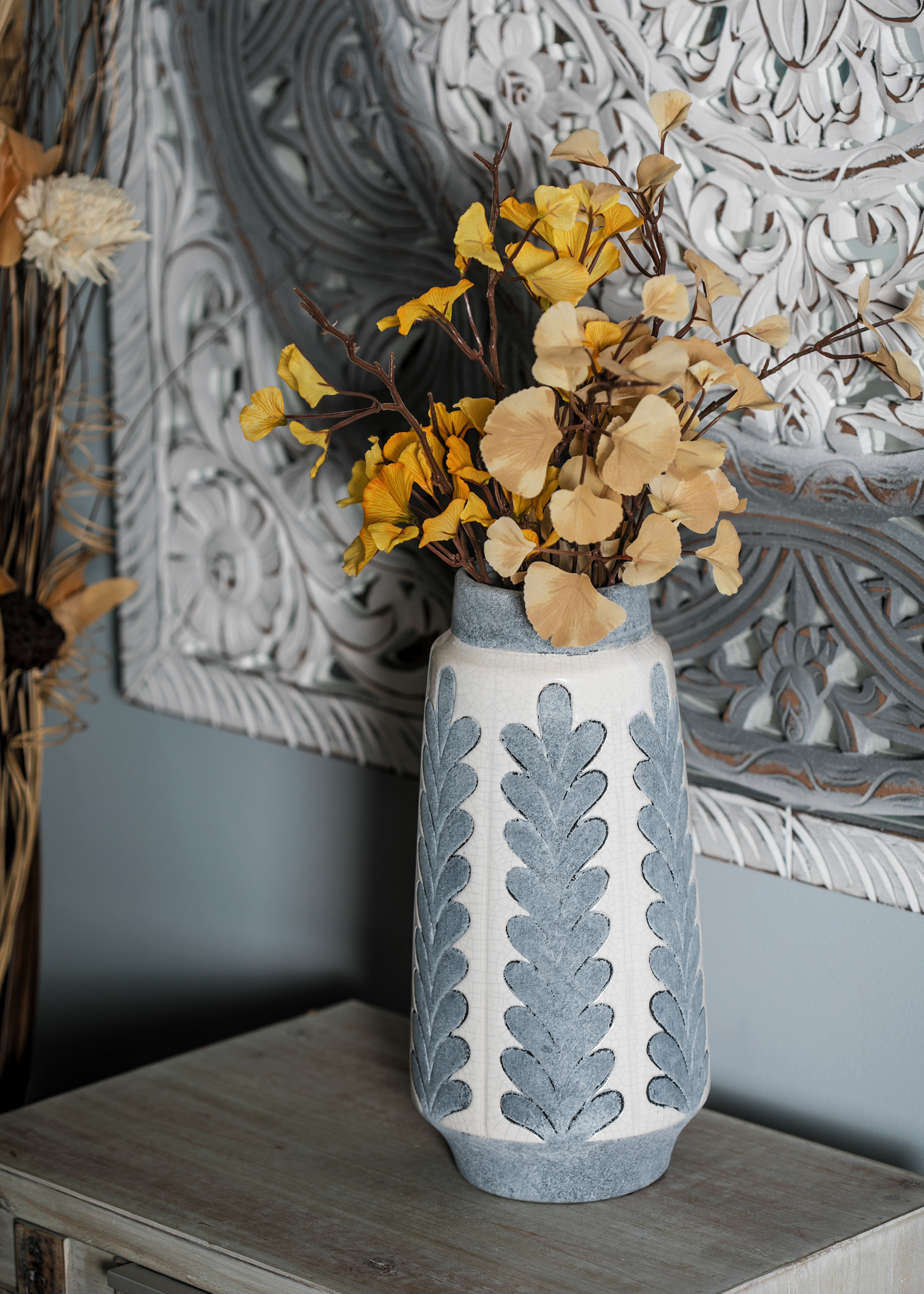The blue and white vase with a leaf design