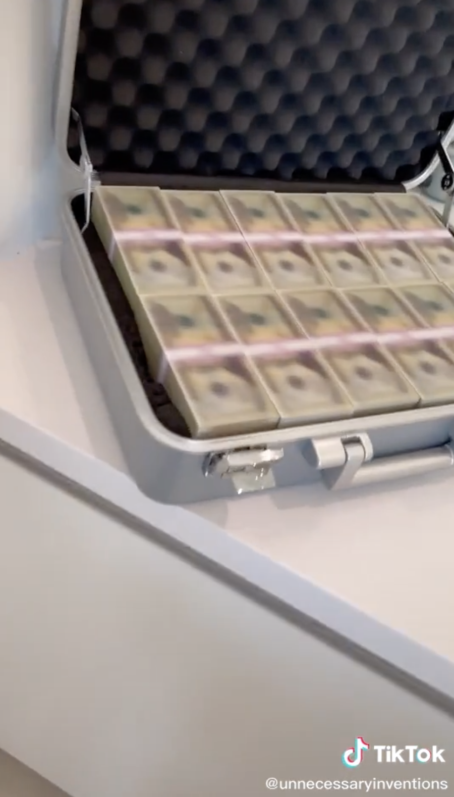 A briefcase filled with blurred money