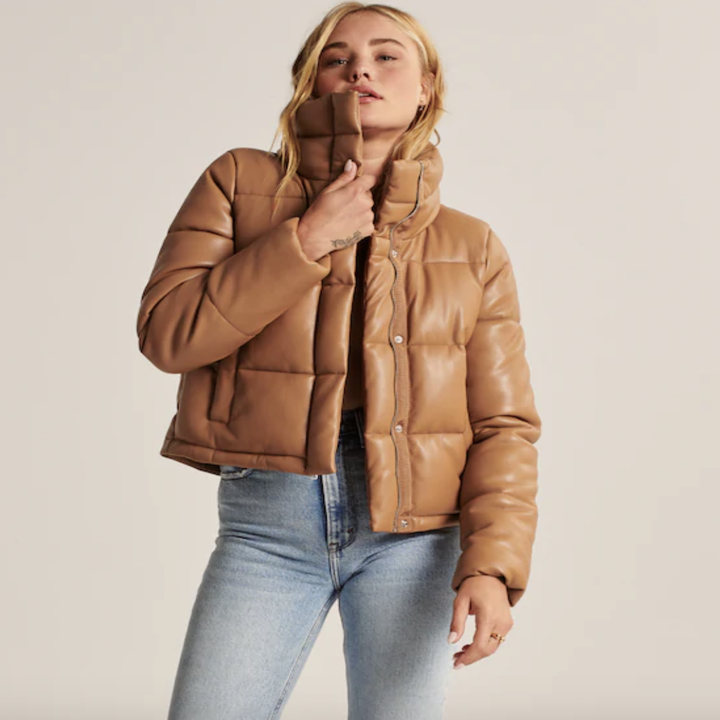 model wearing camel colored puffer