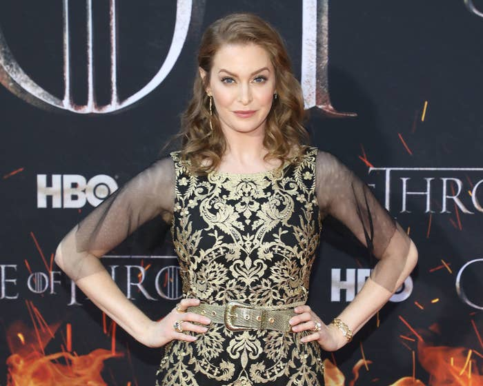 Esmé Bianco wearing a patterned dress with matching belt and sheer sleeves at the premiere of Game of Thrones' eighth season