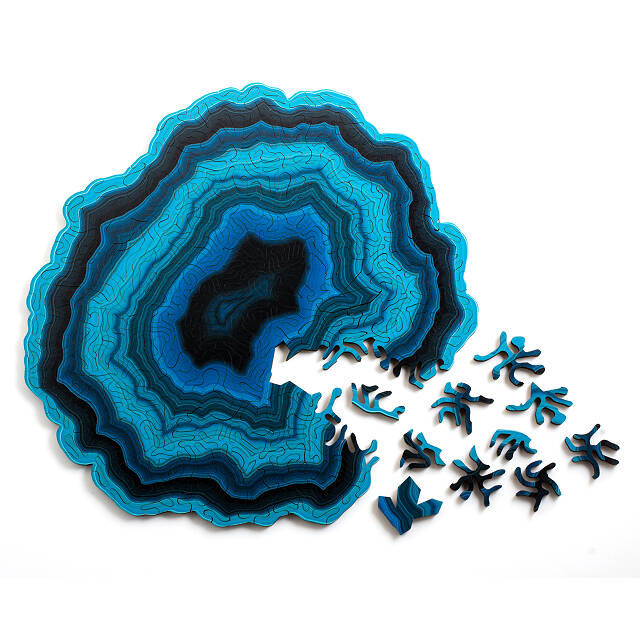 a wooden puzzle shaped like a blue geode