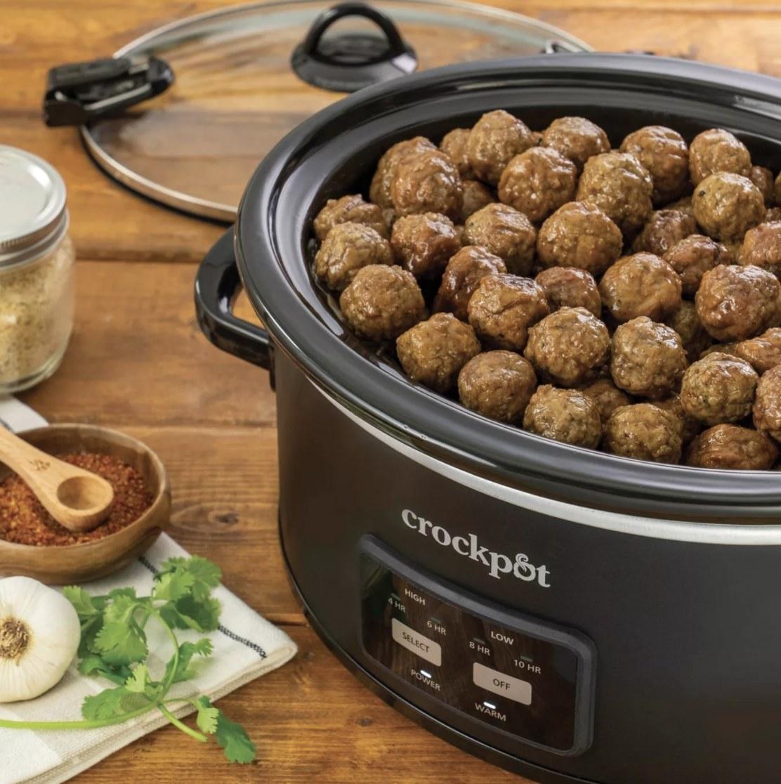 the crock pot with meatballs inside