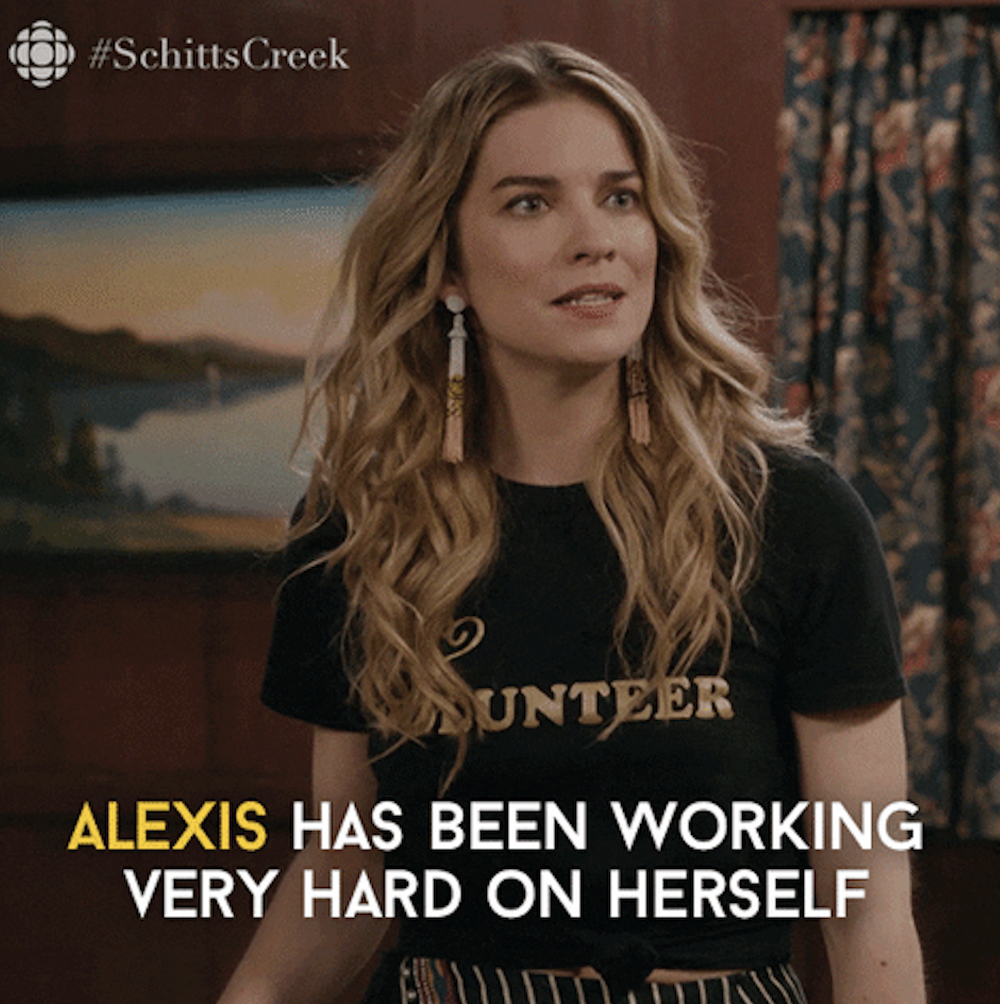 "A scene from ""Schitt's Creek"" that says, ""Alexis has been working on herself"""