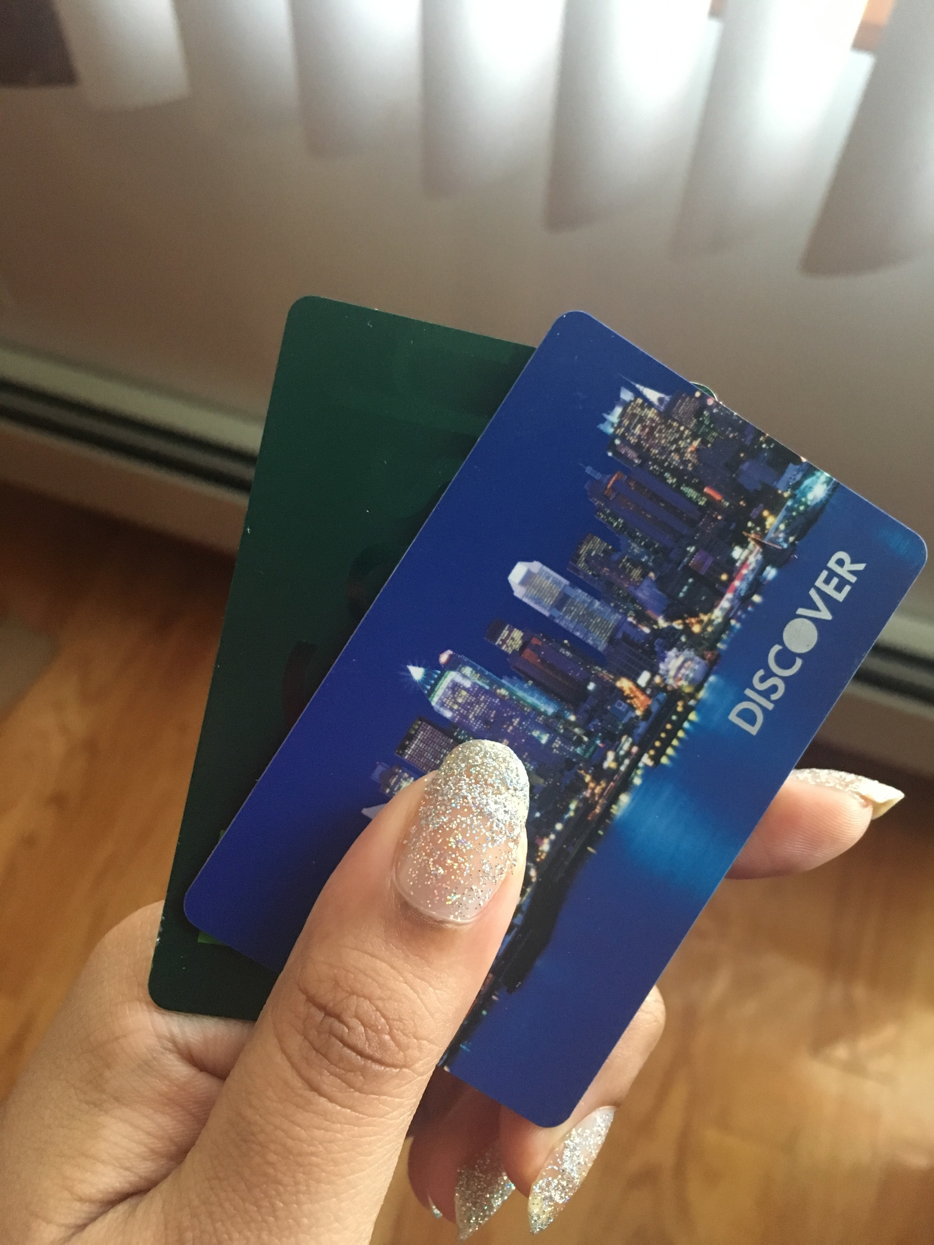someone holding two credit cards