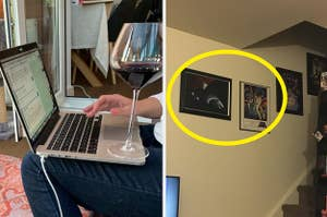 A wine glass sitting on a computer and two pictures hung up incorrectly