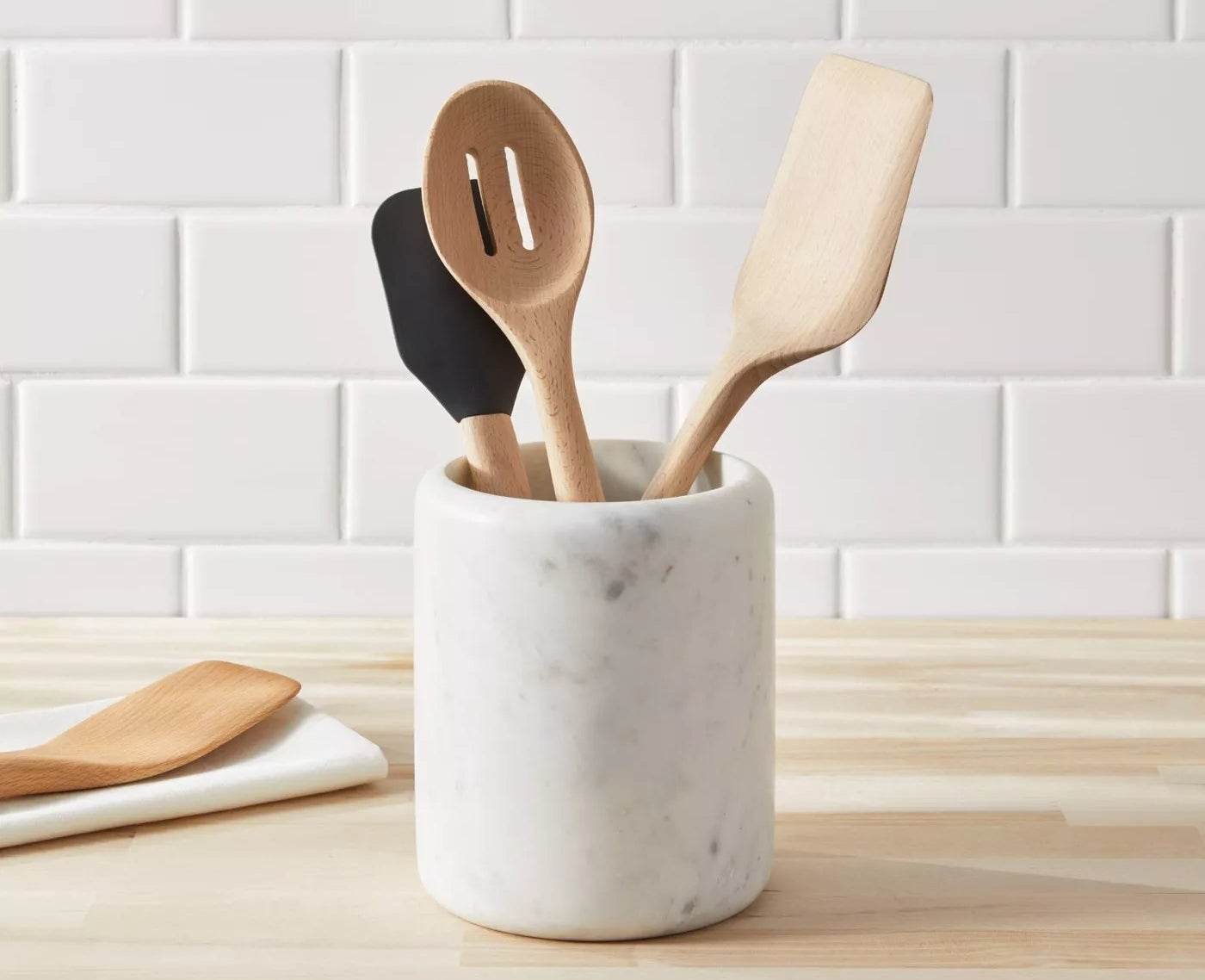 utensil holder with utensils on counter