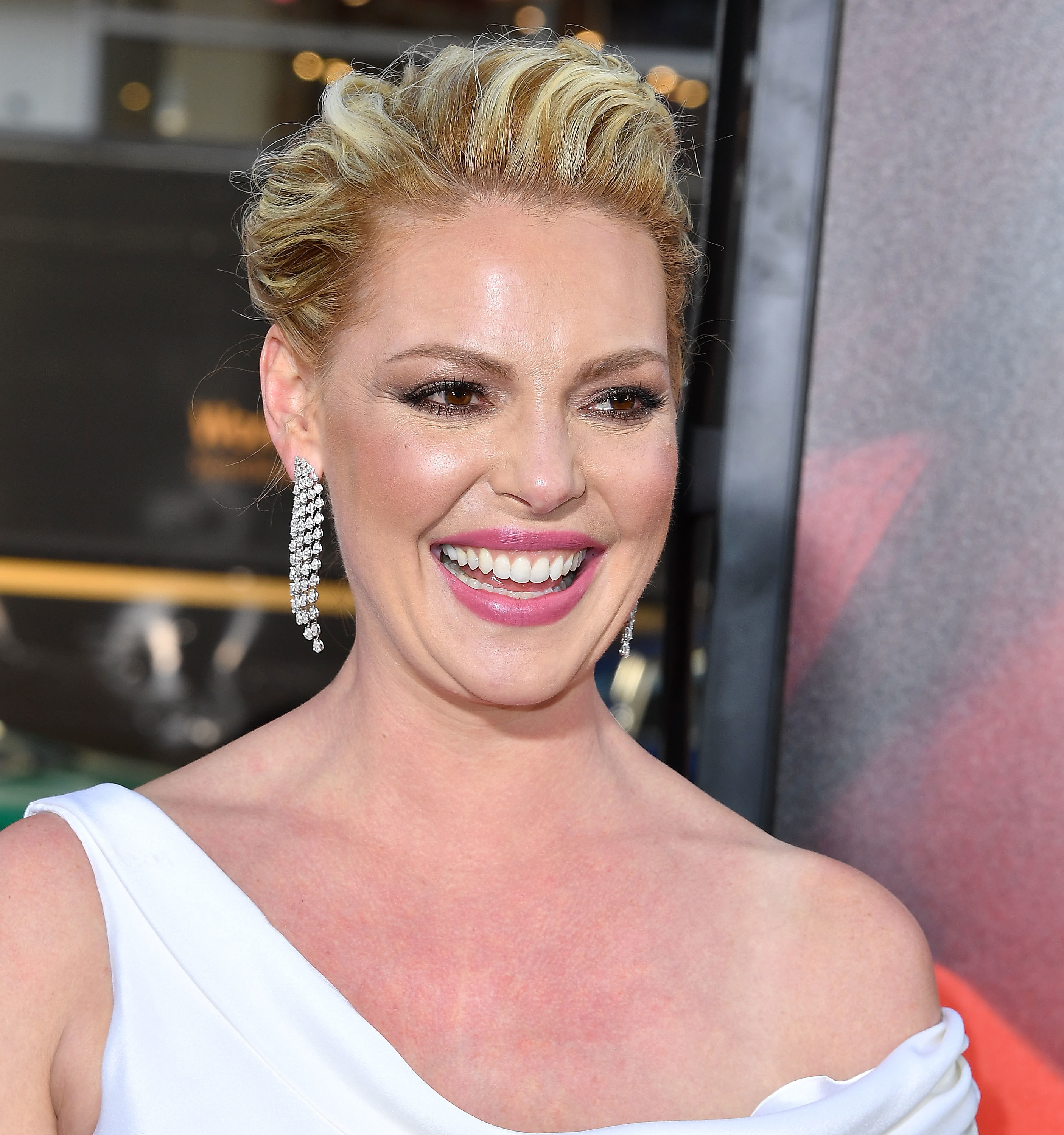 Heigl with a swept updo and long earrings at the premiere of Unforgettable in Hollywood