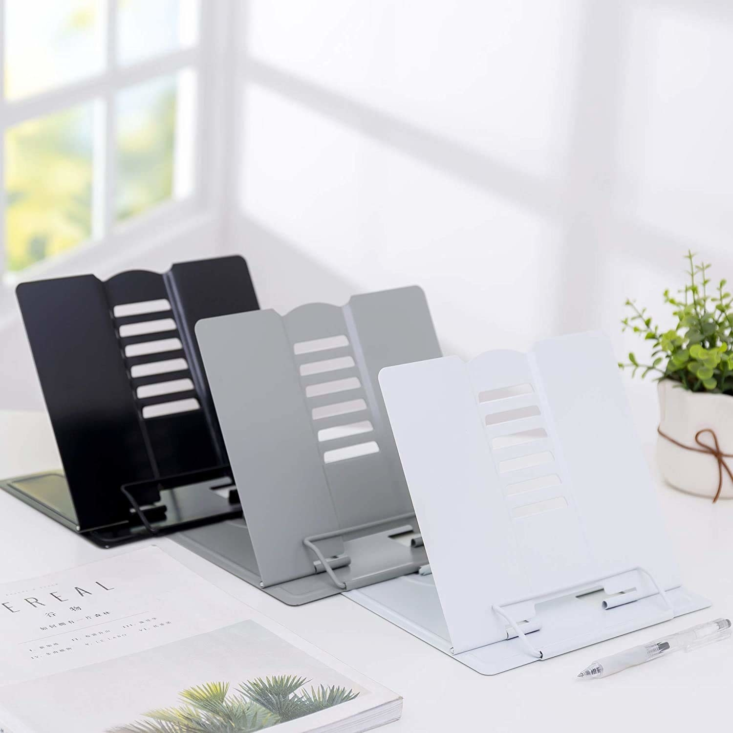 A set of 3 document holders on a table