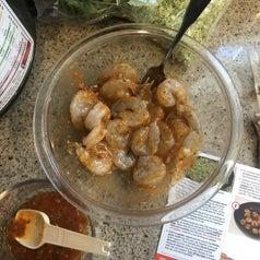 Reviewer's shrimp marinating in a honey harissa sauce mixture