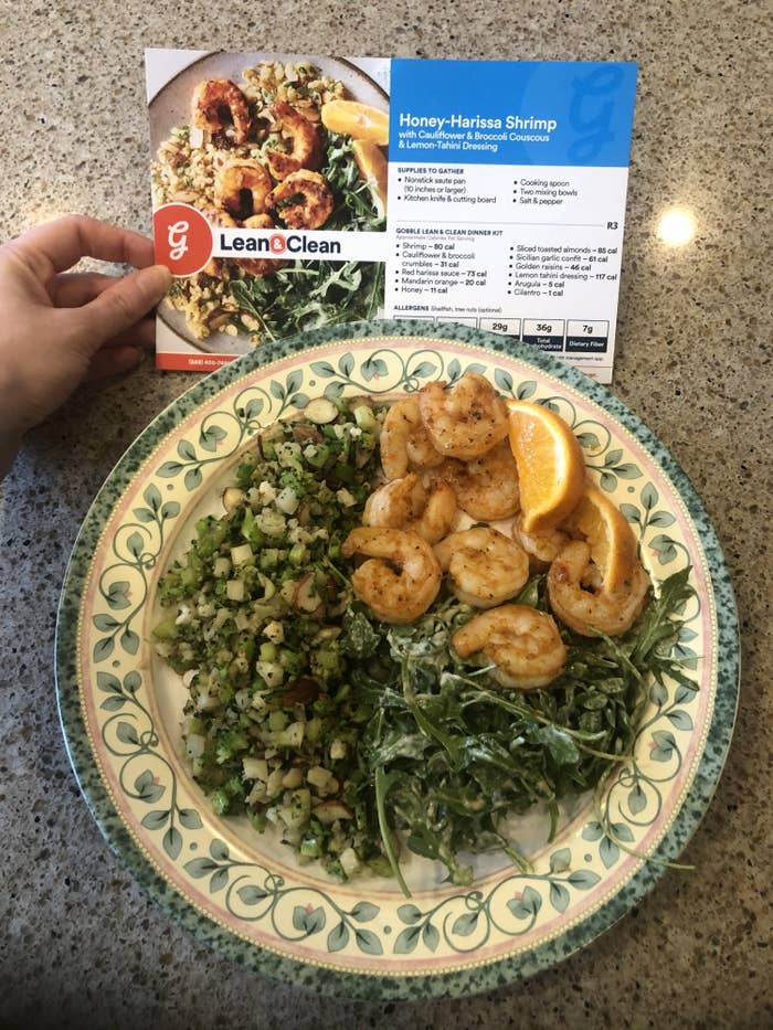 writer's cooked Gobble meal of marinated shrimp with arugula salad and broccoli mix