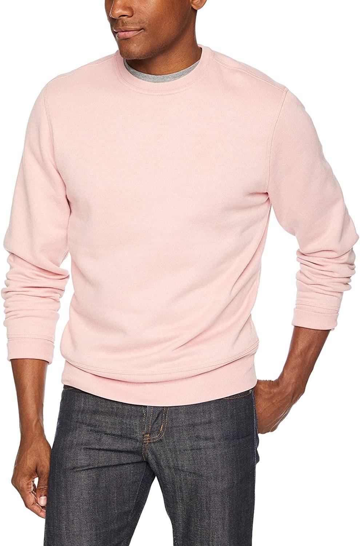 Amazon wears pink crewneck with darkwash jeans