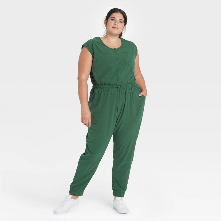 Model in green short sleeve jumpsuit