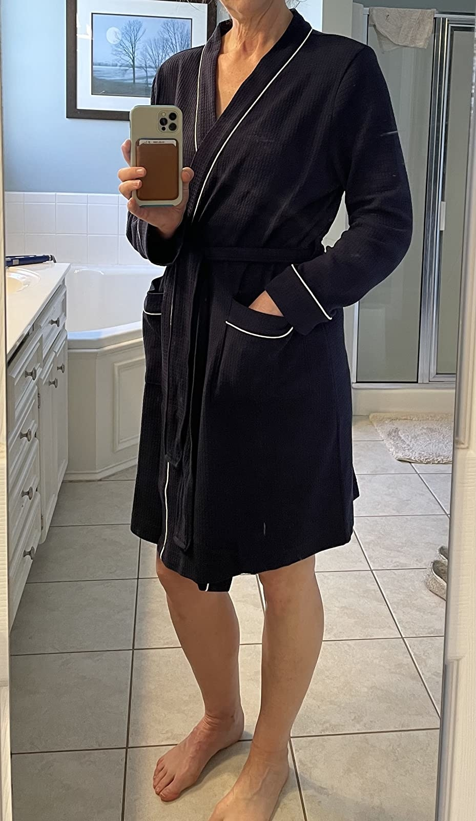 Reviewer's photo of their navy bathrobe with white piping