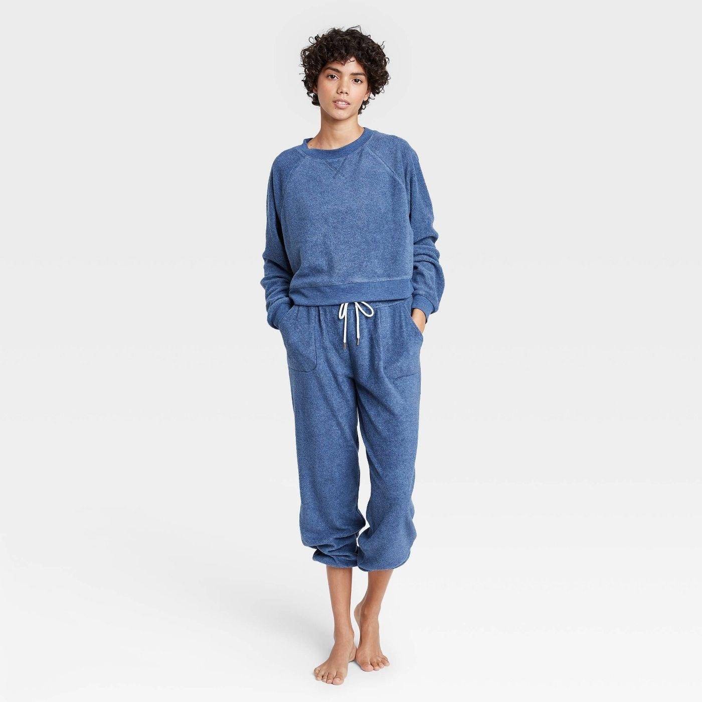 Model in fleece sweatshirt