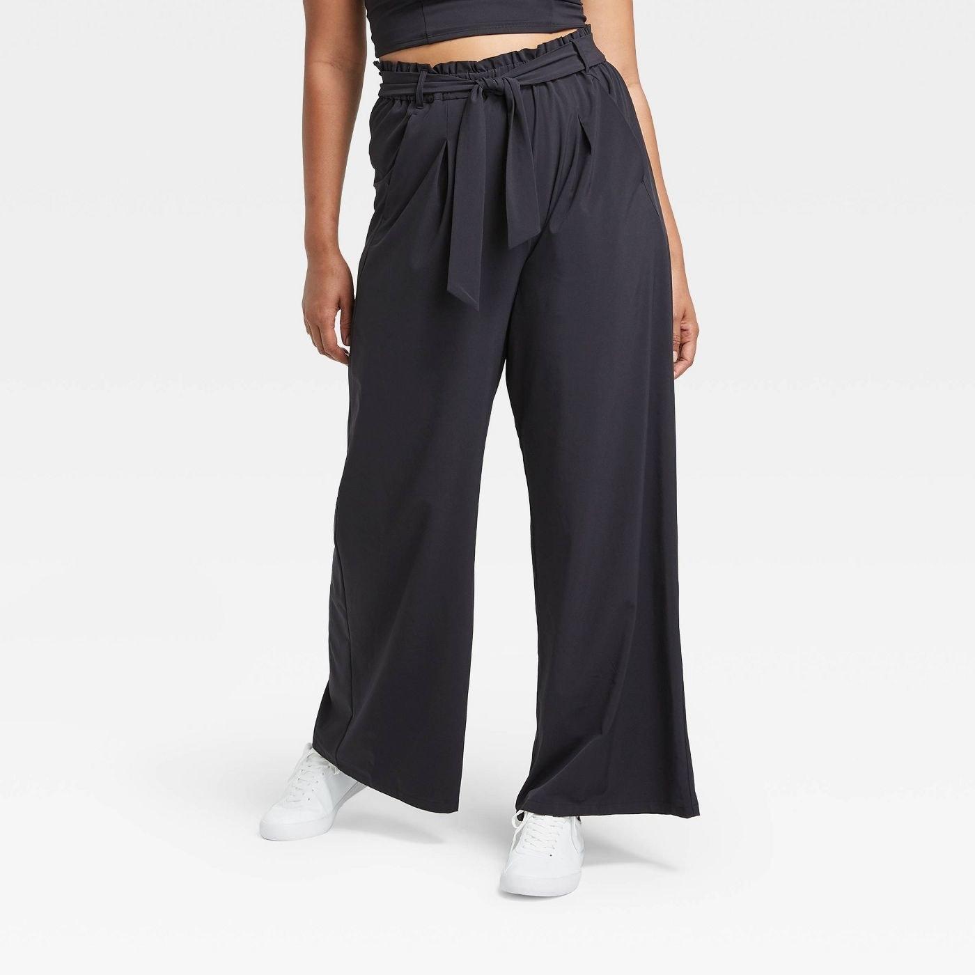 Model in black stretch wide leg pants