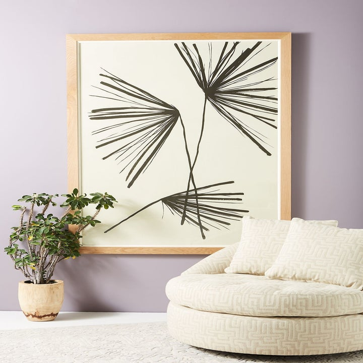 large rectangle art print in cream with black flower-like line design on it in black