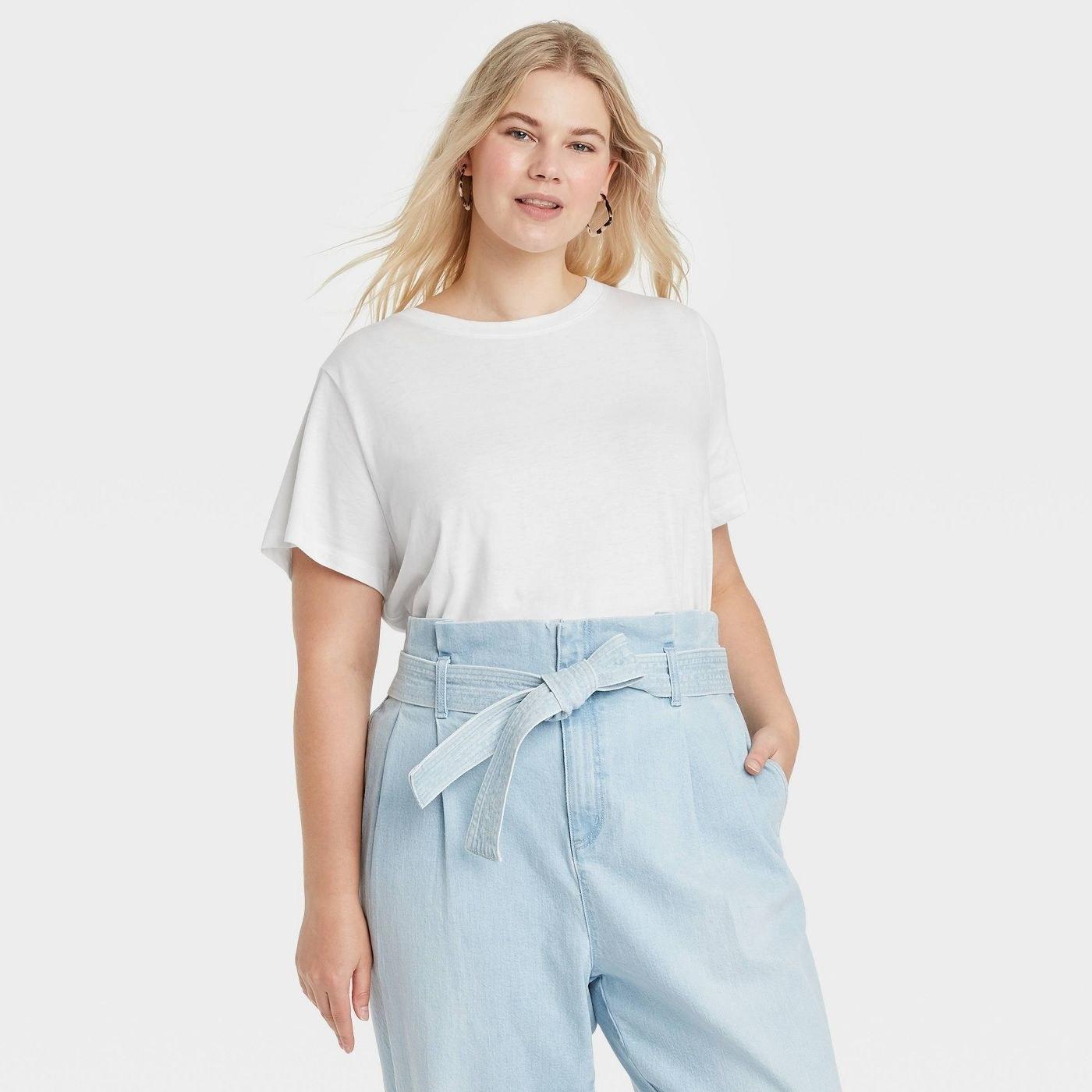 Model in white short sleeve shirt