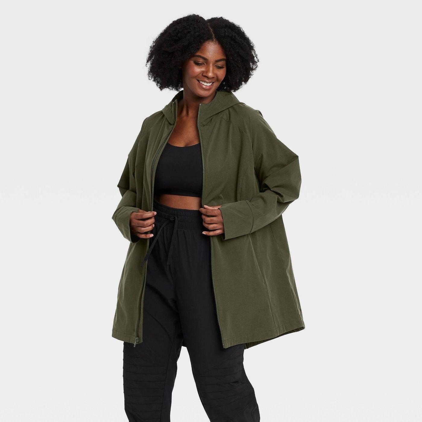 Model in green anorak jacket
