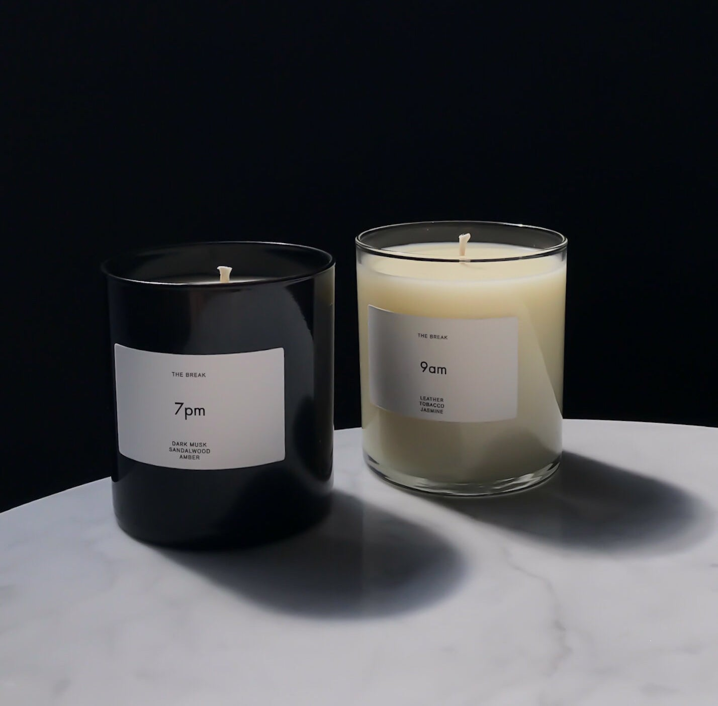the 7pm candle and the 9am candle on a marble surface