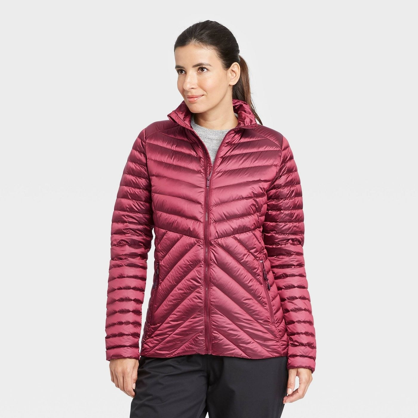 Model in packable down puffer jacket