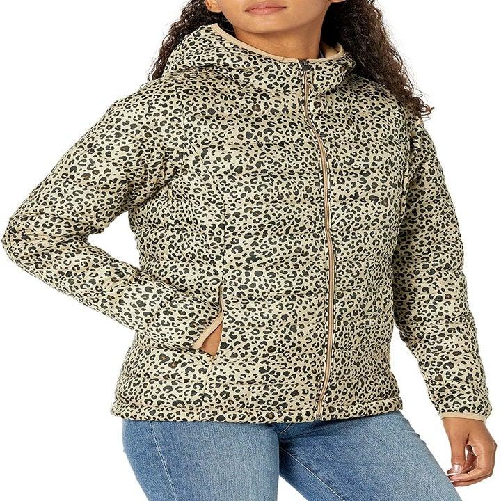 model wearing hooded leopard print jacket