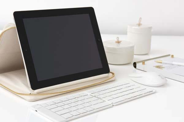 Keyboard next to tablet on table