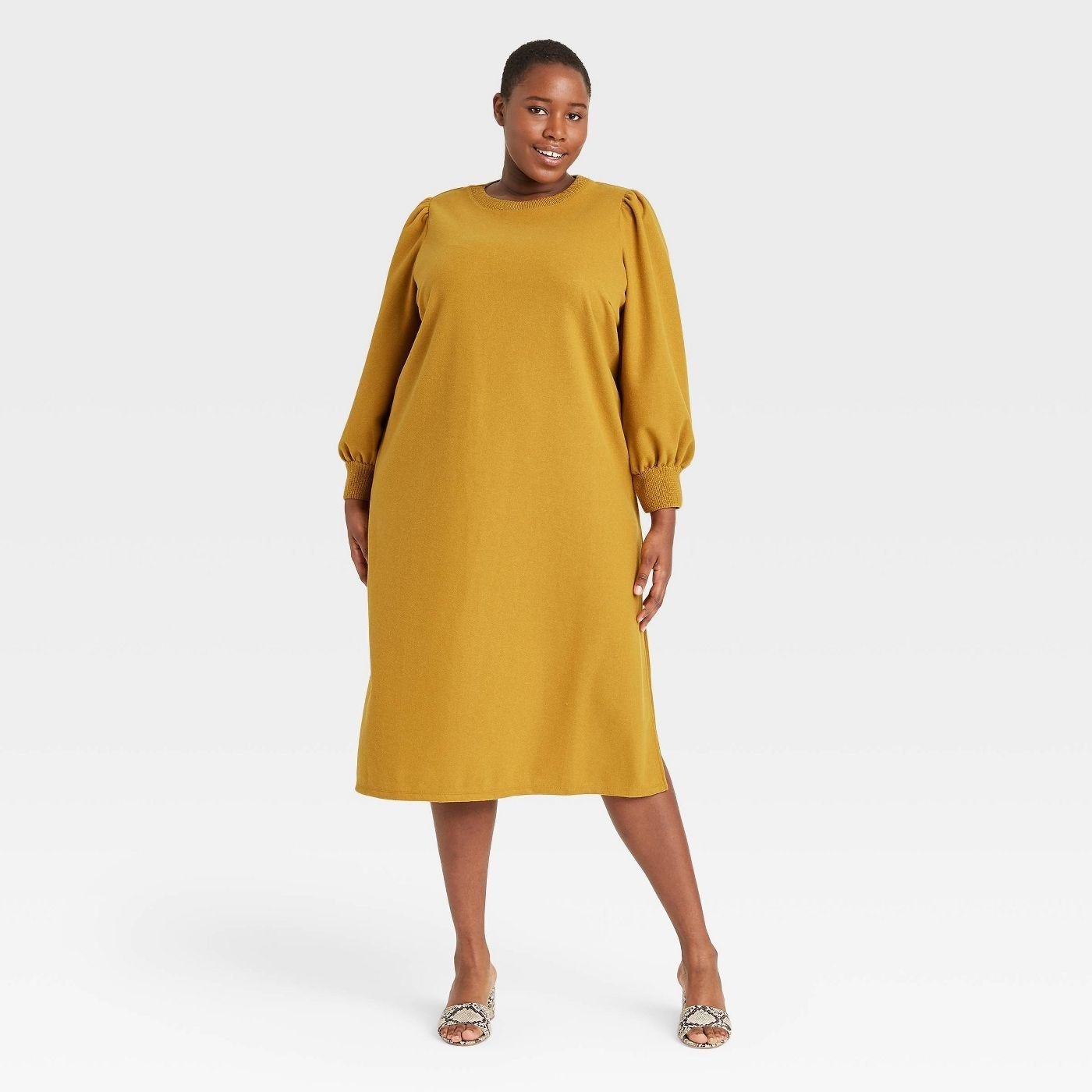 Model in the burnt yellow dress
