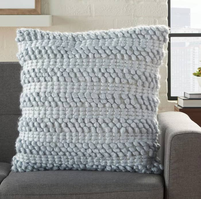 The woven square pillow in blue