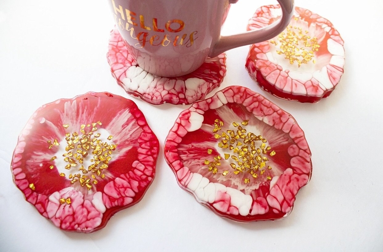 red and white coasters with gold specks in the middle