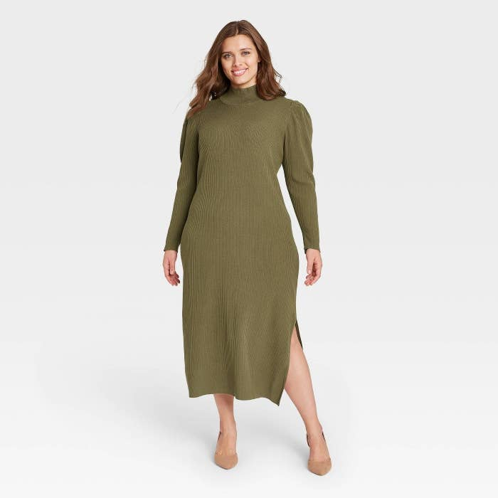 Model wearing the turtleneck dress with side slits
