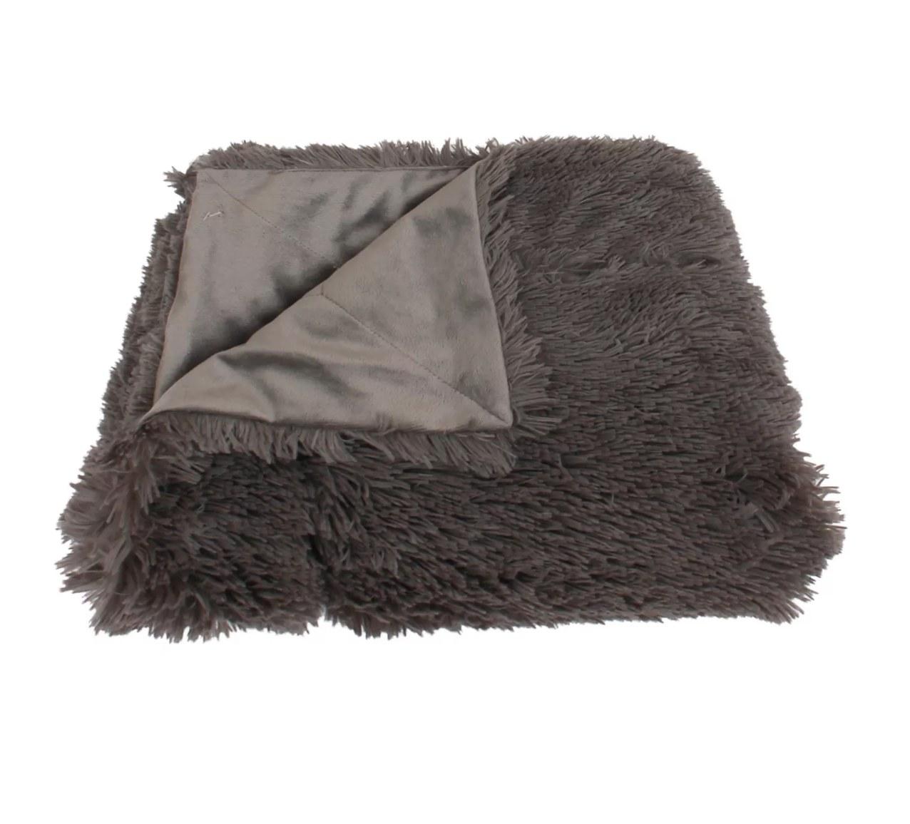 The faux fur blanket in gray
