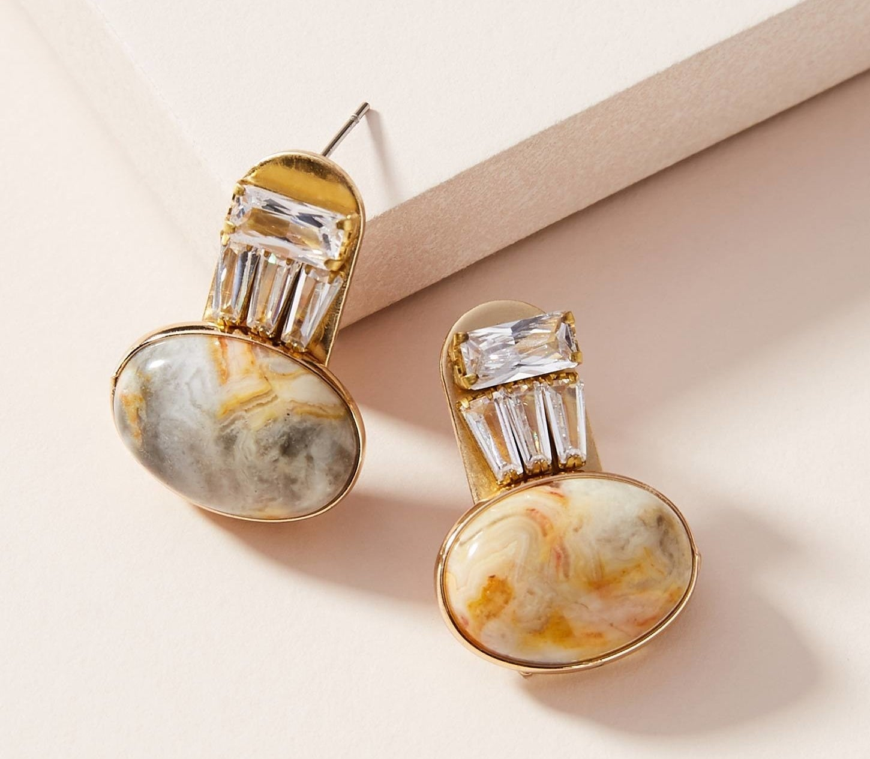 Earrings on beige background